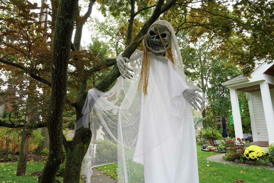 """The Luciano home on Brinkerhoff Avenue in New Canaan is amply decorated for Halloween. """"At this time, we are just relying on the good judgment of our residents to do what's right with their individual families,"""" Murphy, who is new to the post, said. """"It is a personal, family decision."""" """"All of this is Covid contingent, like we say all the time. If something should happen, if cases increase significantly or if the health department is seeing some sort of trend, the town is prepared, and will if they have to, cancel Halloween,"""" Murphy, the former executive director of the Chamber of Commerce, said. The town may have to """"change on a dime,"""" she added. The New Canaan Health Department will make the final decision, she said. Halloween this year """"comes on a Saturday, which is a little problematic, it just means they can stay out a little bit longer, a little bit later,"""" Murphy said.  Photo: Grace Duffield / Hearst Connecticut Media"""