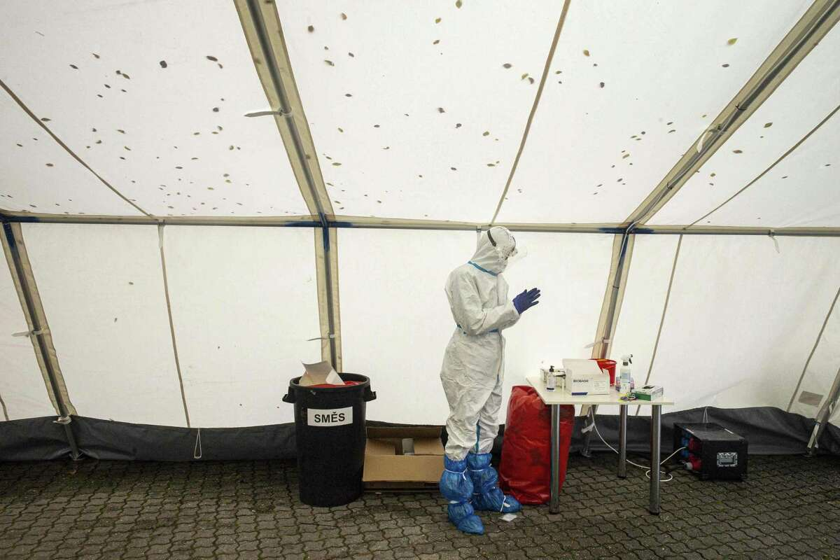 A medical worker wearing personal protective equipment waits for a patient at the drive-in Covid-19 coronavirus testing station on October 14, 2020 in Prague. Excess deaths Take an average of how many deaths there are every year, and compare it to how many people have actually died and you get something called