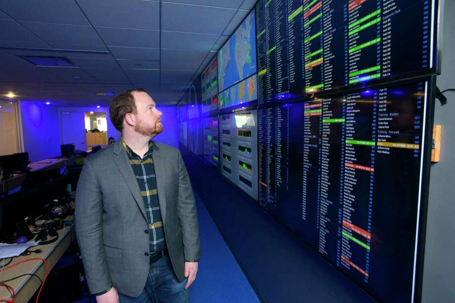 Datto CEO Austin McChord is photographed on Thursday, Jan. 28, 2016 at his company's new re-designed Headquarters in Norwalk, Connecticut. Datto provides comprehensive backup, recovery and business continuity solutions to businesses worldwide. Photo: Matthew Brown / Hearst Connecticut Media / Stamford Advocate
