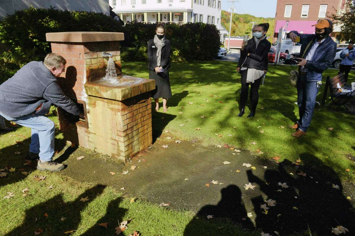 Ballston Spa Mayor Larry Woolbright, left, turns on the fountain during an event at Wiswall Park on Wednesday, Oct. 14, 2020, in Ballston Spa, N.Y. Mayor Woolbright unveiled the town's comprehensive economic development plan at the event which was also held to show off the newly repaired fountain fed by the Historic San Souci Spring. (Paul Buckowski/Times Union)