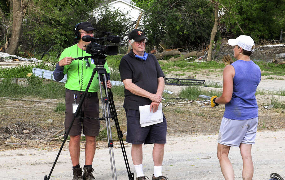 """Bob Przybylski, left, and Ron Beacom, center, conduct an interview with Sanford resident Kathy Parsch, right, on June 4, while filming for their documentary film, """"Breached!"""" which centers on the May 19 mid-Michigan dam failures. (Photo provided/Bob Przybylski) Photo: (Photo Provided/Bob Przybylski)"""