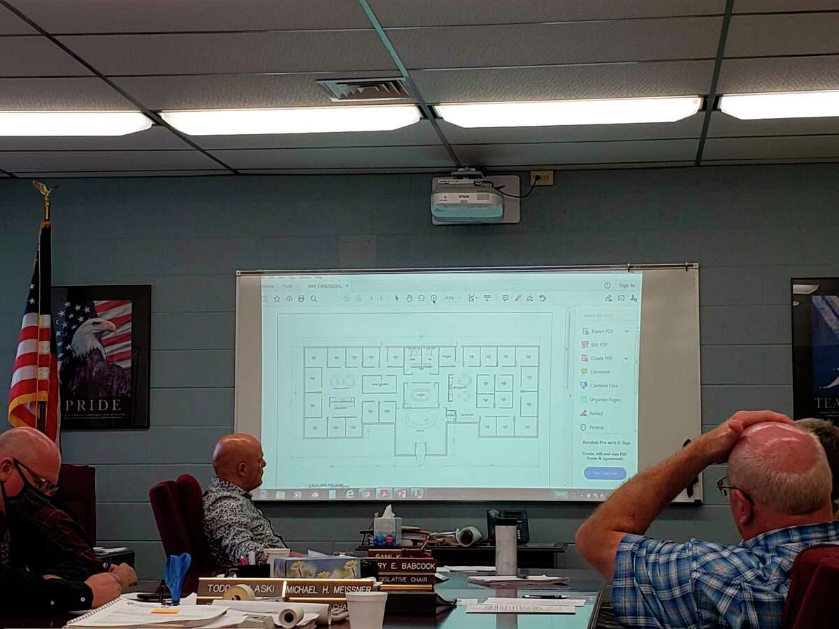 The Huron County commissioners look at a preliminary layout of the new MSU Extension building during this week's commissioners meeting. A finalized version will be done in two weeks. (Robert Creenan/Huron Daily Tribune)