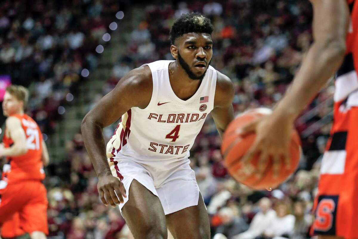 Patrick Williams #4 of the Florida State Seminoles defends the ball during the game against the Syracuse Orange at the Donald L. Tucker Center on February 15, 2020 in Tallahassee, Florida. Florida State defeated Syracuse 80 to 77.