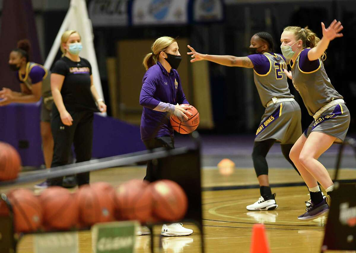 UAlbany women's basketball coach Colleen Mullen, center, said the Supreme Court's decision gets close to questioning the definition of amateurism and what a professional athlete is.