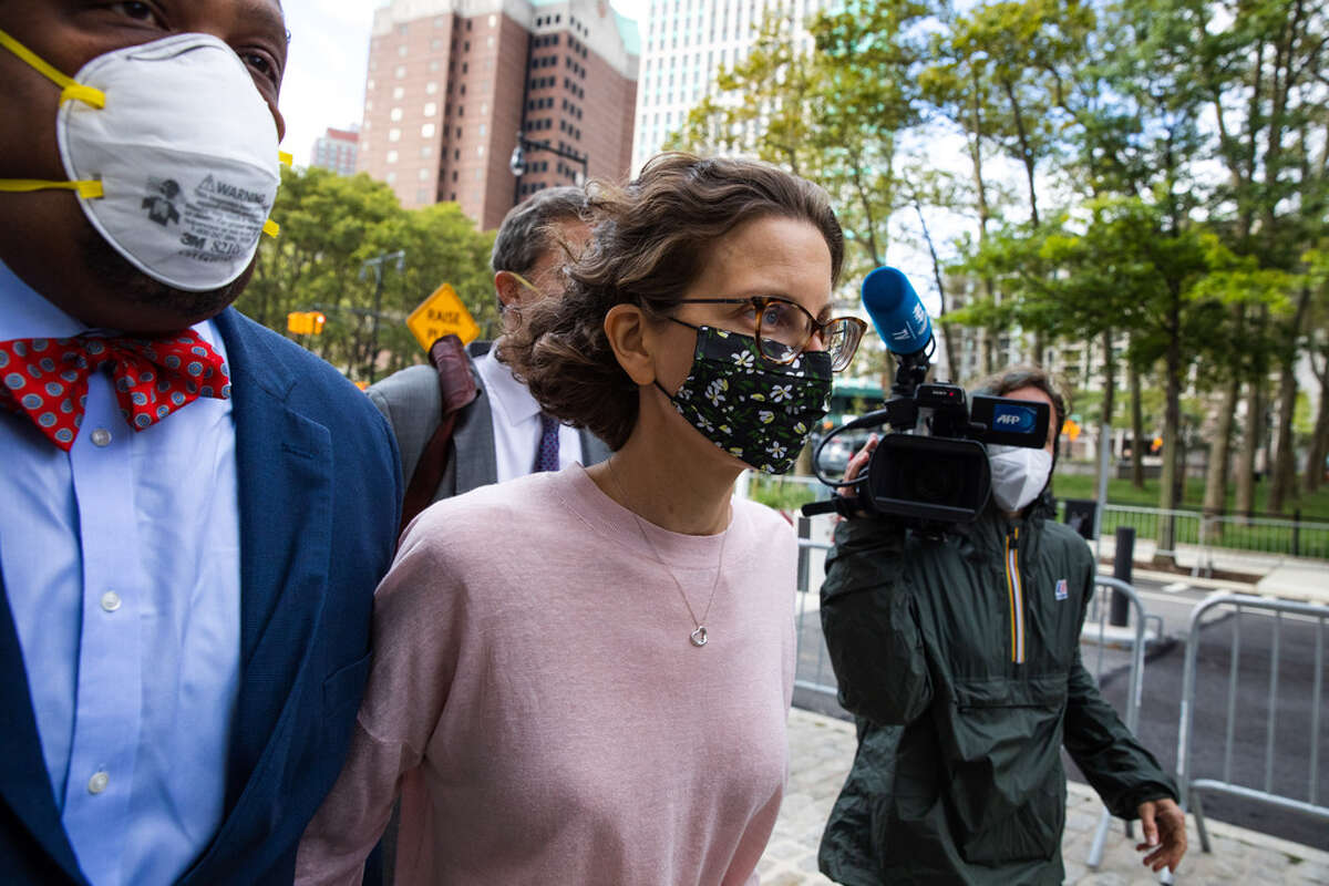 ClareBronfman,daughter of former Seagram ChairmanEdgar M. Bronfman, center, arrives at federal court in the Brooklyn borough of New York, U.S., on Wednesday, Sept. 30, 2020. Bronfmanwas charged with helping finance the activities of Nxivm, an upstate New York cult accused of branding its victims and forcing them to participate in sex acts. She pleaded guilty to conspiracy charges and could spend more than two years in federal prison. Photographer: Paul Frangipane/Bloomberg
