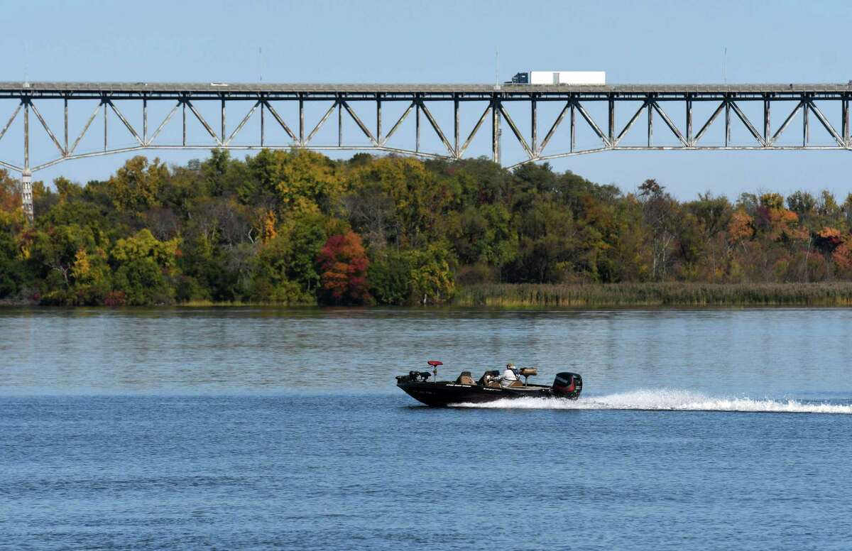 A high powered fishing boat motors up the Hudson River toward Rip Van Winkle Bridge under sunny skies on Wednesday, Oct. 14, 2020, seen from Dutchmen's Landing Park in Catskill, N.Y. (Will Waldron/Times Union)