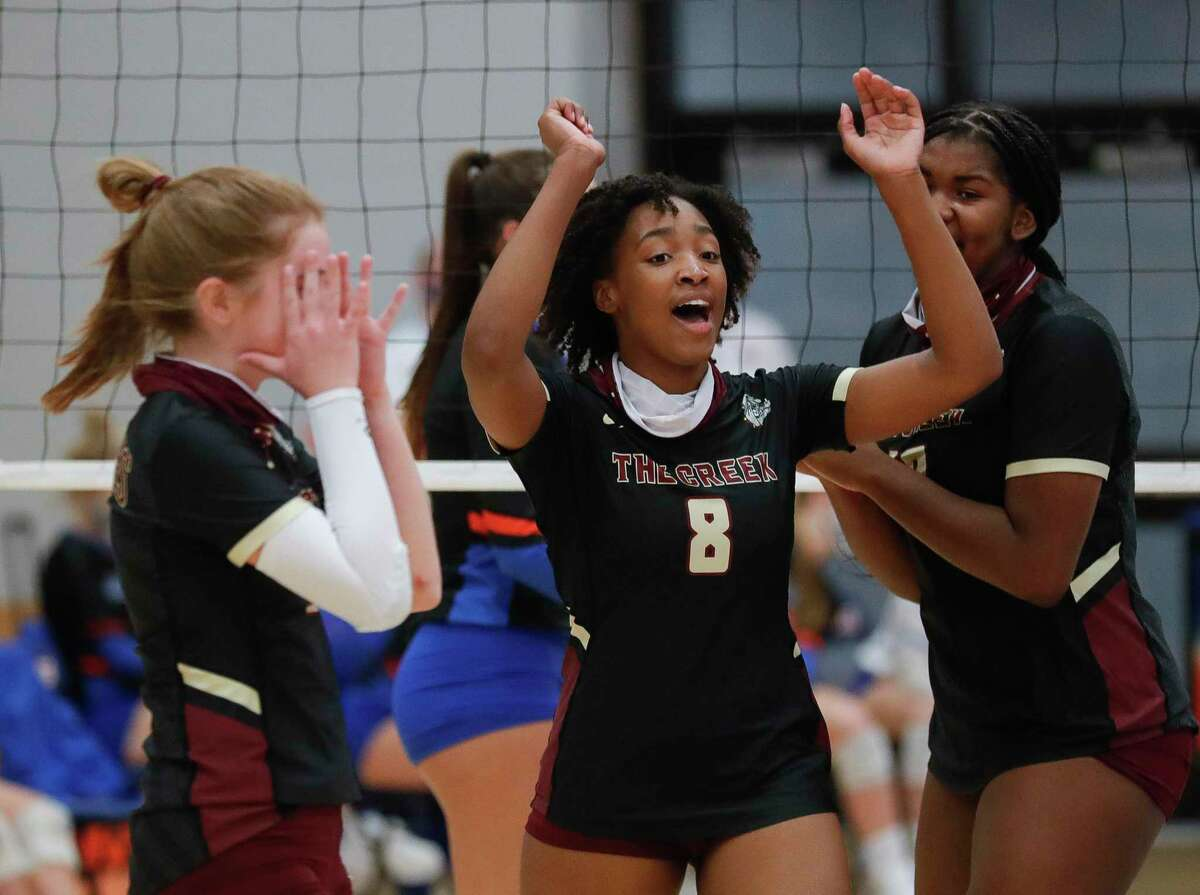 Summer Creek right side hitter Kaitlyn Honora (8) reacts after a block during a non-district high school volleyball match at Grand Oaks High School, Tuesday, Sept. 29, 2020, in Spring.