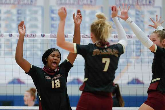 Summer Creek middle hitter Aspen Maxwell (18) reacts after scoring a point during a non-district high school volleyball match at Grand Oaks High School, Tuesday, Sept. 29, 2020, in Spring.