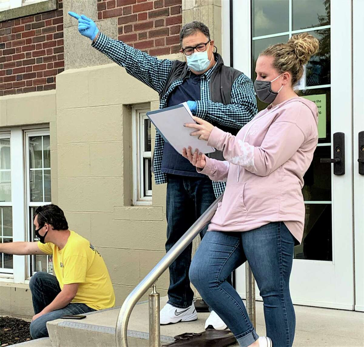 """Middlletown High School Unified Theater students practice outside for """"10 Years of Unified,"""" which begins its run at the end of October. The teens, together in small cohorts, rehearsed outside this year due to the pandemic. They're shown here at the Middletown Senior Center."""
