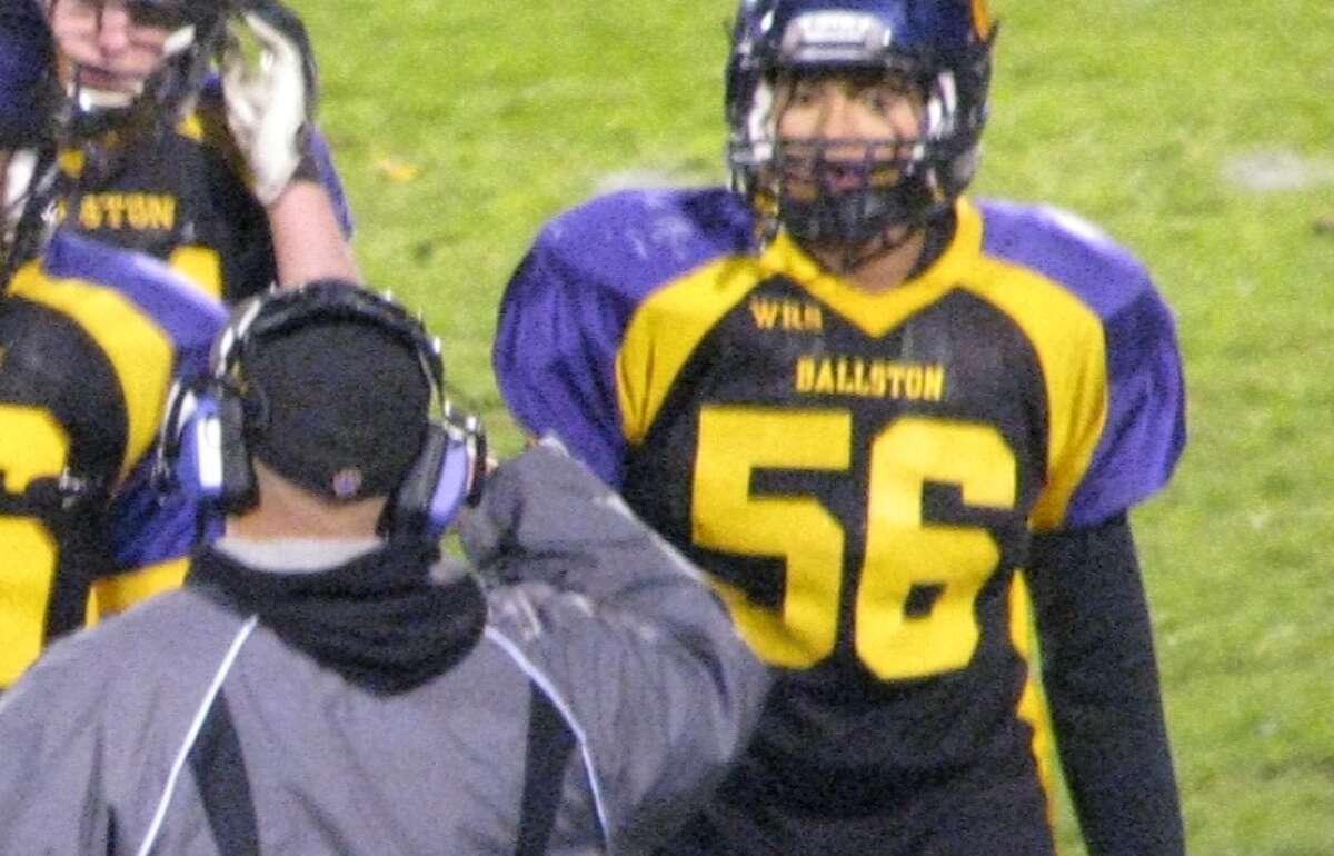 Will Oates, with Coach Dave Murello, at a Ballston Spa High School football game. (Courtesy of Coach Dave Murello)