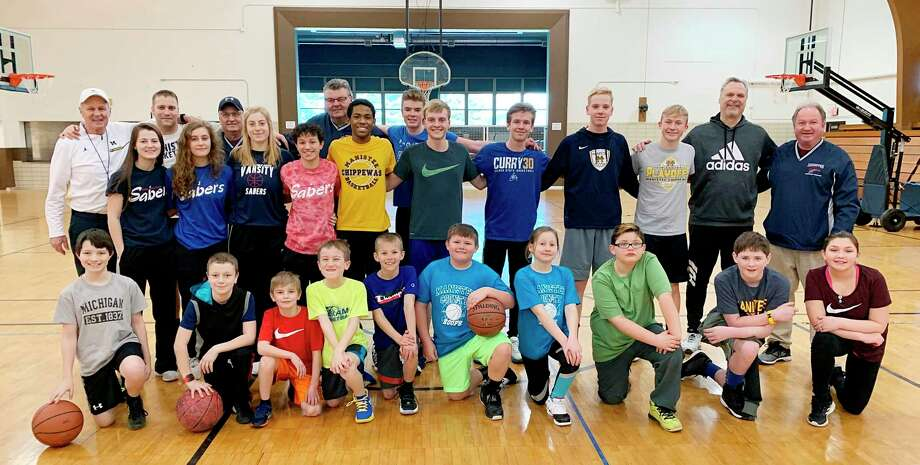 Pictured are the participants and coaches from thefinal sessionof the Armory Youth Project's inaugural youth basketball clinic, which ran in January and February. The Armory, along with the Manistee Recreation Association, is hosting a fall basketball clinic for youth in grades three through six. (File photo)