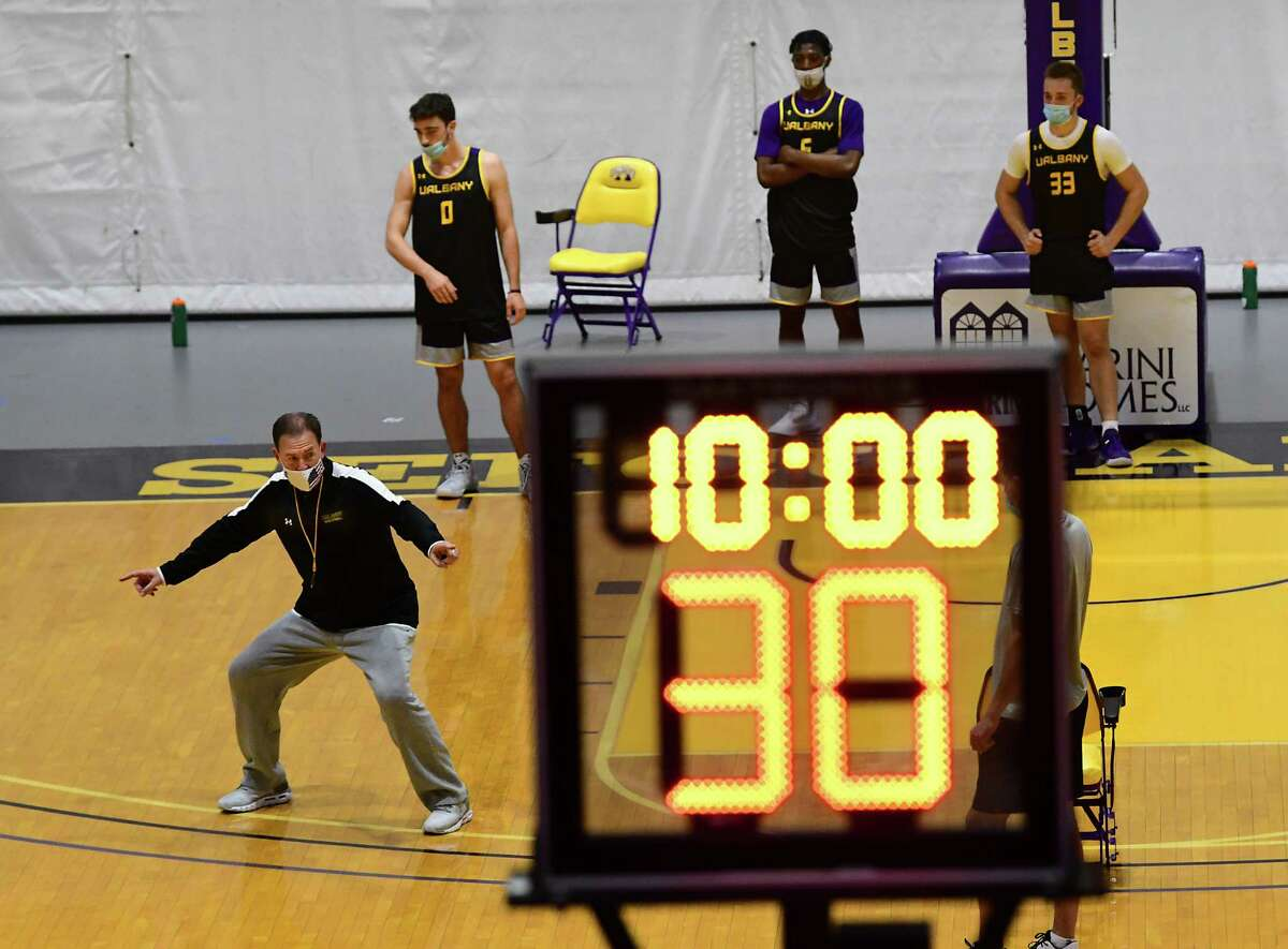 Men?•s basketball coach Will Brown, left, is seen on the court as the team practices in the SEFCU Arena at University at Albany on Wednesday, Oct. 14, 2020 in Albany, N.Y. (Lori Van Buren/Times Union)