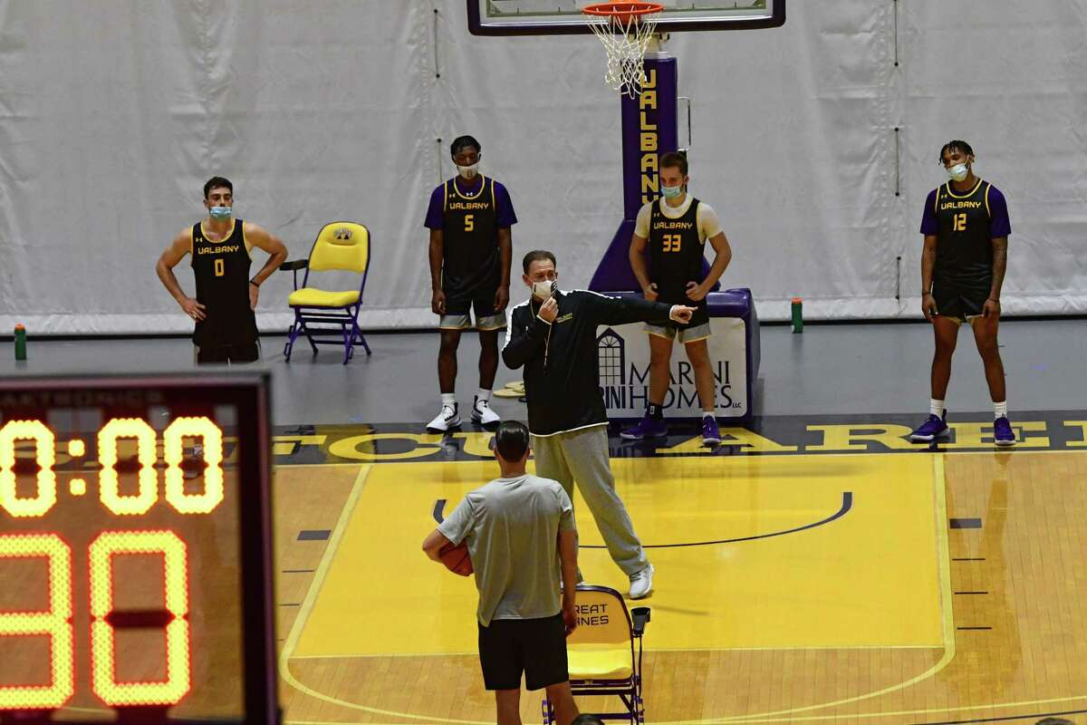 Men?•s basketball coach Will Brown, center, is seen on the court as the team practices in the SEFCU Arena at University at Albany on Wednesday, Oct. 14, 2020 in Albany, N.Y. (Lori Van Buren/Times Union)