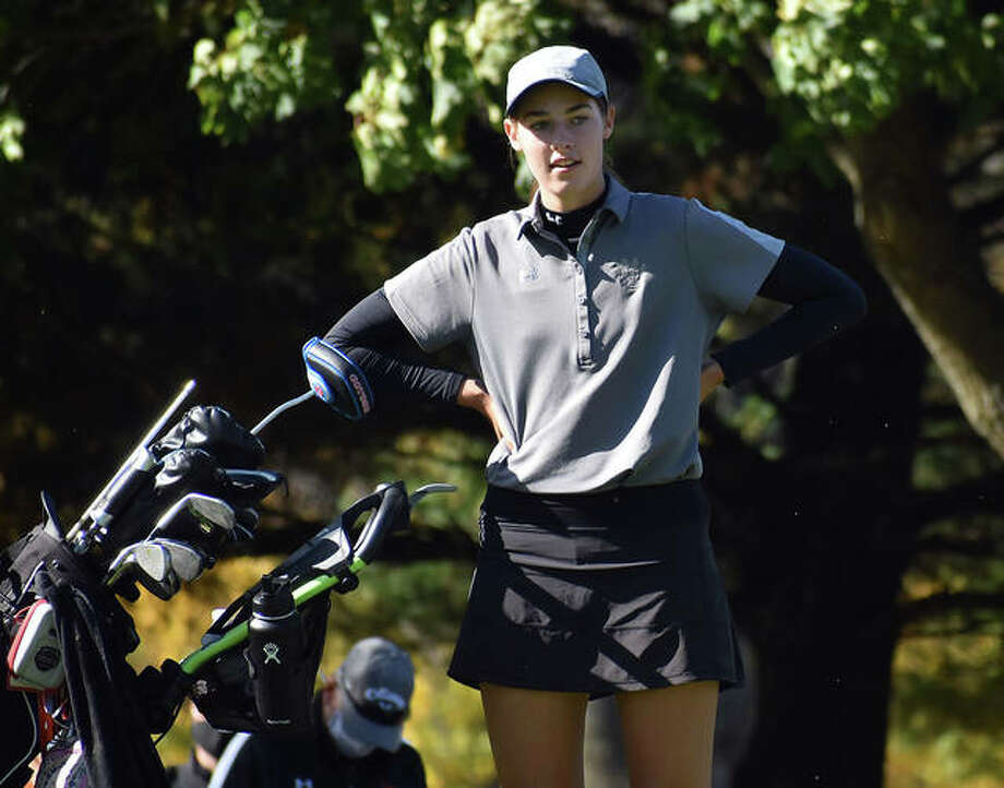 Edwardsville sophomore Nicole Johnson waits patiently on the green after ending her round and winning the Class 2A Champaign Centennial Sectional title. Photo: Matt Kamp|The Intelligencer