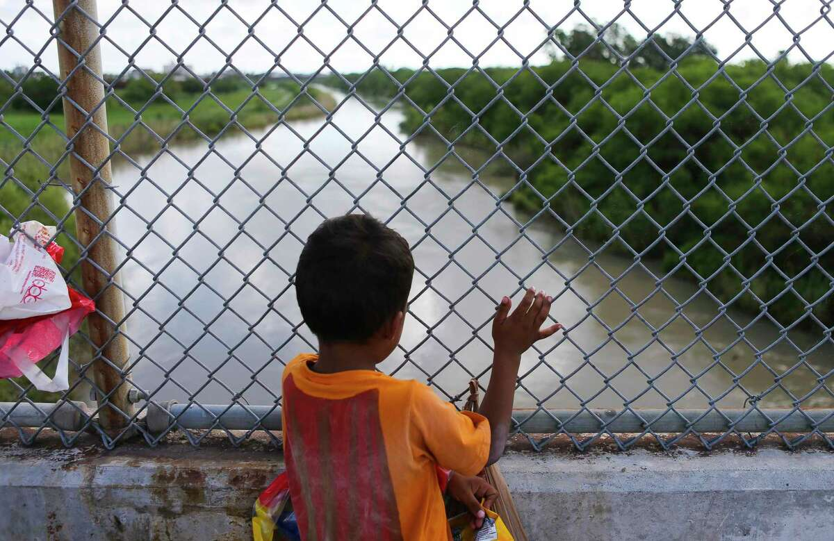 Five-year-old Jesus Bindel Rodriguez, from Honduras, waits on the Mexican side of the middle of the Brownsville & Matamoros Express International Bridge for the fourth day in a row hoping for his family to be able to pass together into the United States to seek asylum, Wednesday, June 27, 2018 in Brownsville. Jesus, along with his parents and three siblings, is hoping to escape violence threats against the family in their hometown in Honduras. ( Mark Mulligan / Houston Chronicle )