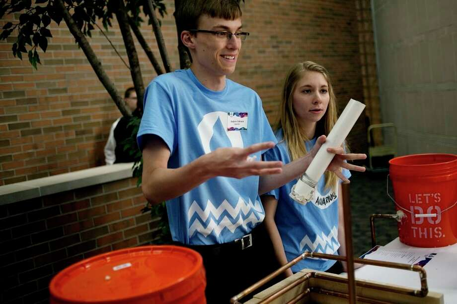 Midland High's Team Aquarius members Andrew Johnson, left, and Katie Knapp participate in the second annual A.H. Nickless Innovation Award competition. Even thoughthis year's competition was canceled because of COVID-19,the Nickless Family Charitable Foundation isoffering scholarships. (Daily News file photo)
