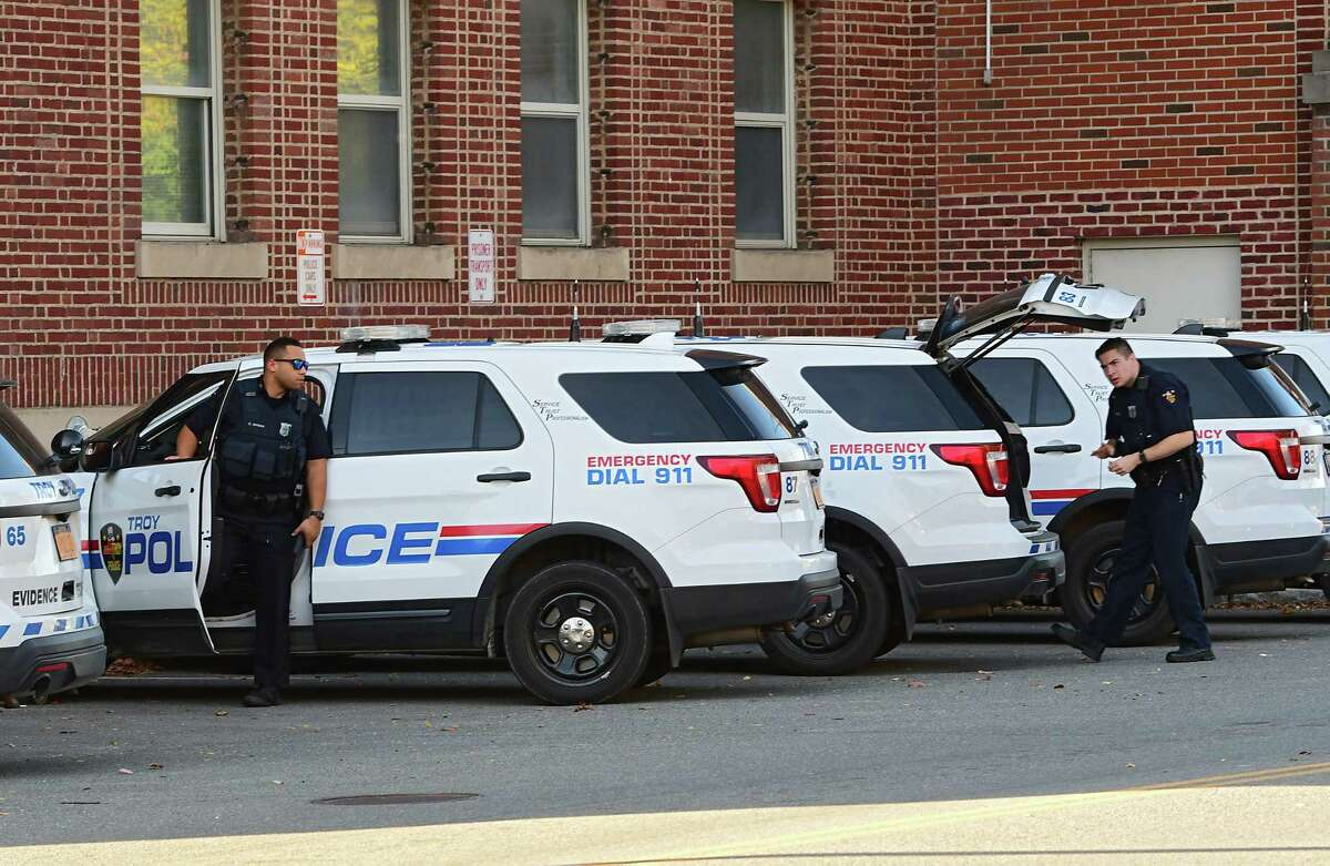 Police officers are seen outside the Troy Police Station on Wednesday, Oct. 14, 2020 in Troy, N.Y. (Lori Van Buren/Times Union)