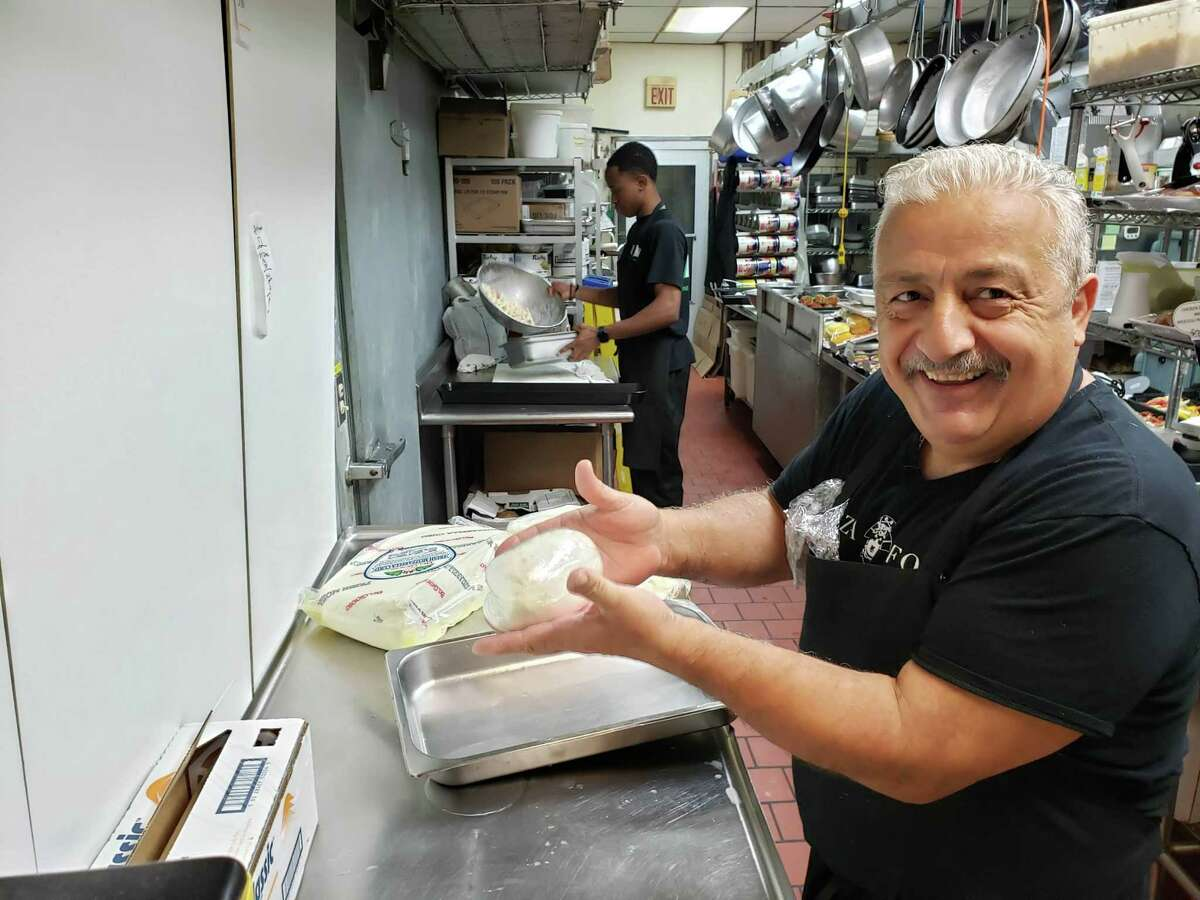 Angelo Competiello with fresh-made mozzarella at A-S Foods in Norwalk.