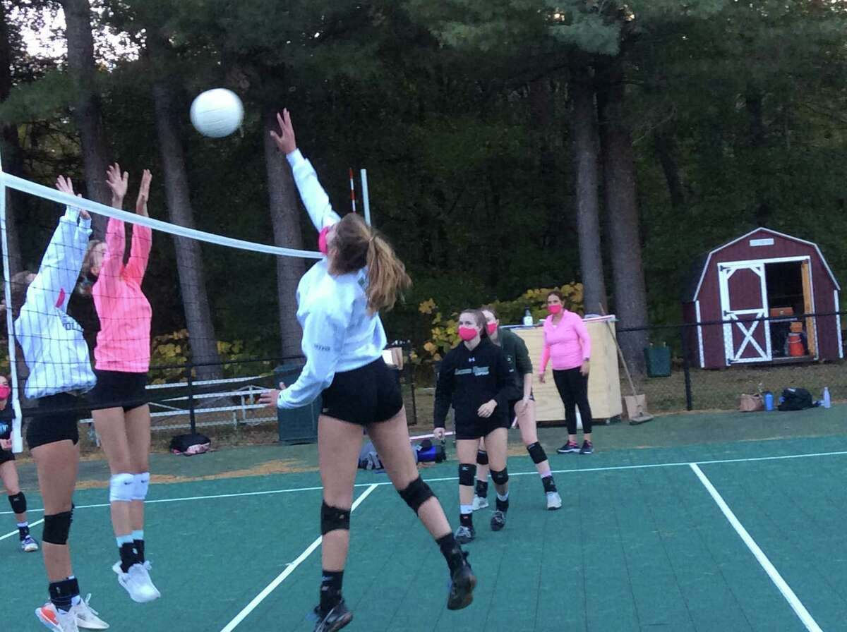 Olivia Lockwood, right, is a senior captain of the Sacred Heart Greenwich volleyball team.