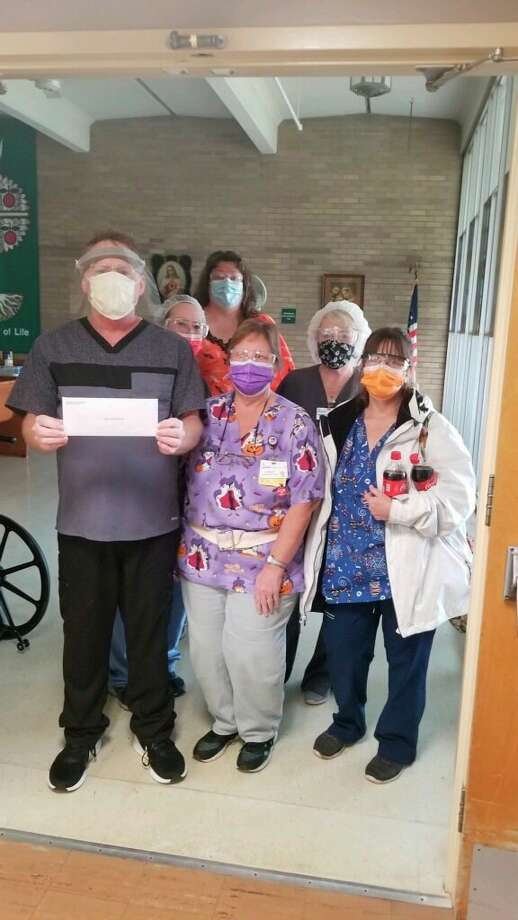 Service Employees International Union membersat Manistee County Medical Care Facility deliver a letter to medical care facility administrator Joe Coleman on Wednesday. (Courtesy Photo)