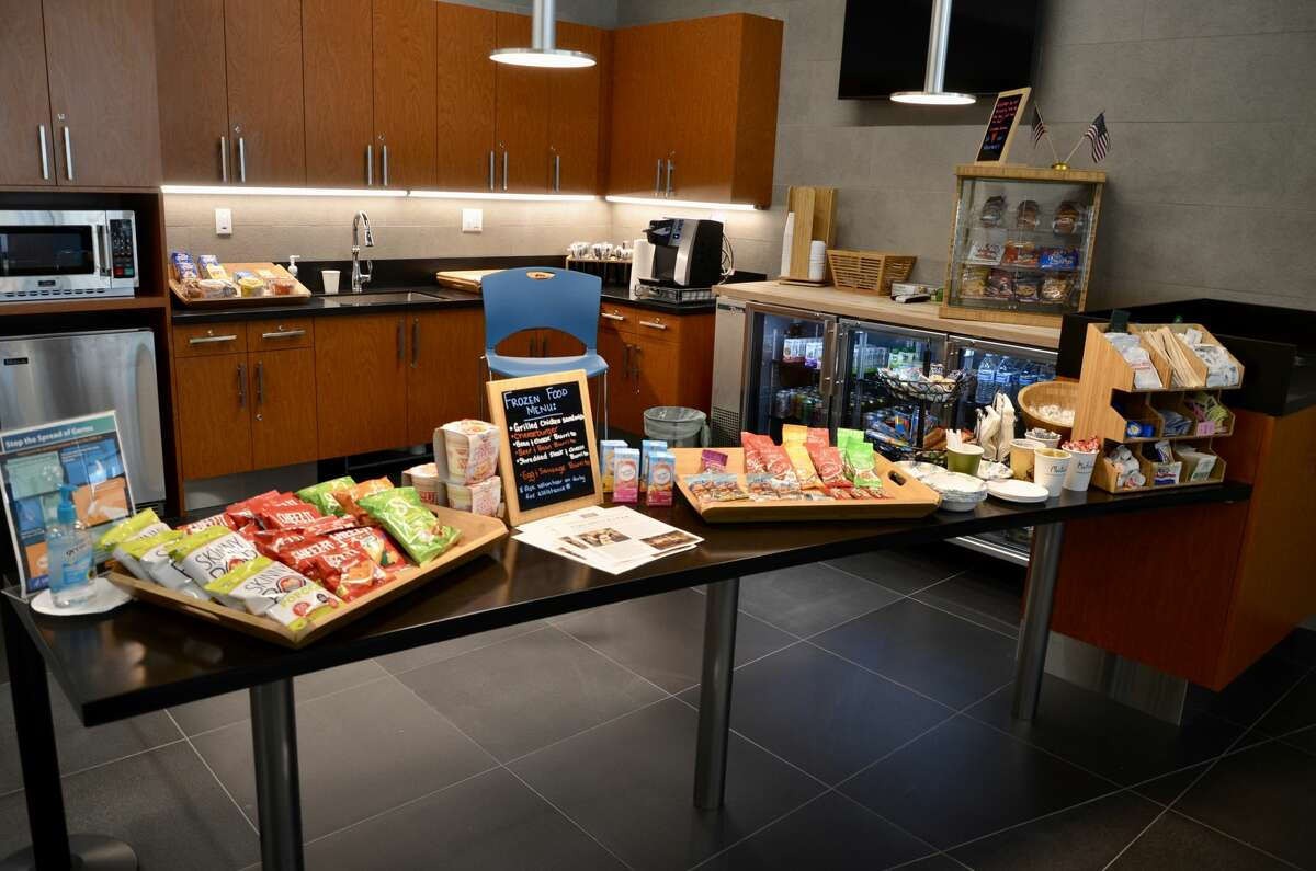 Assorted snacks are available for free to all guests. A volunteer prepares and serves warm items as a measure against COVID-19.