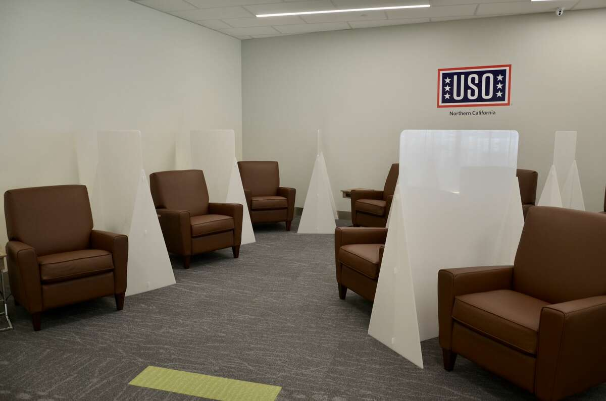 Plastic partitions have been installed between seats to create a germ barrier between guests seated in these recliners.