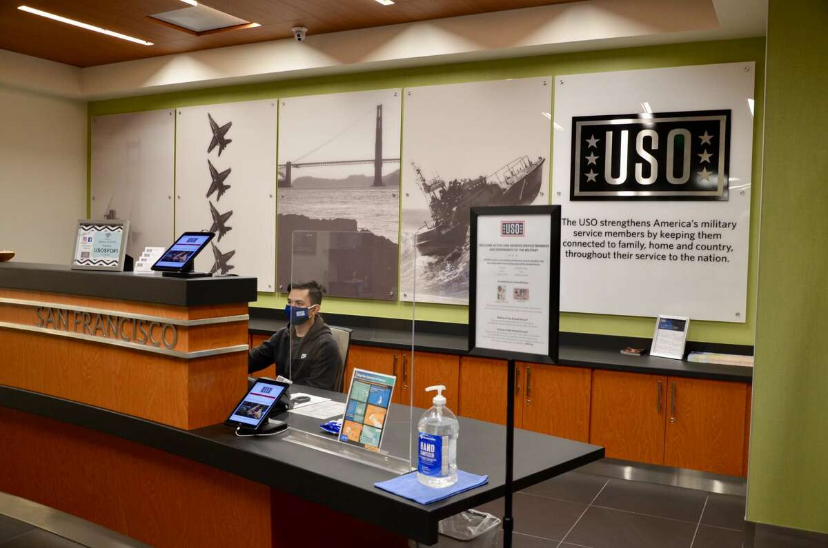 Hand sanitizer, plastic dividers and photographs of the U.S. Navy Blue Angels and the Golden Gate Bridge greet guests to the new USO Center at SFO.