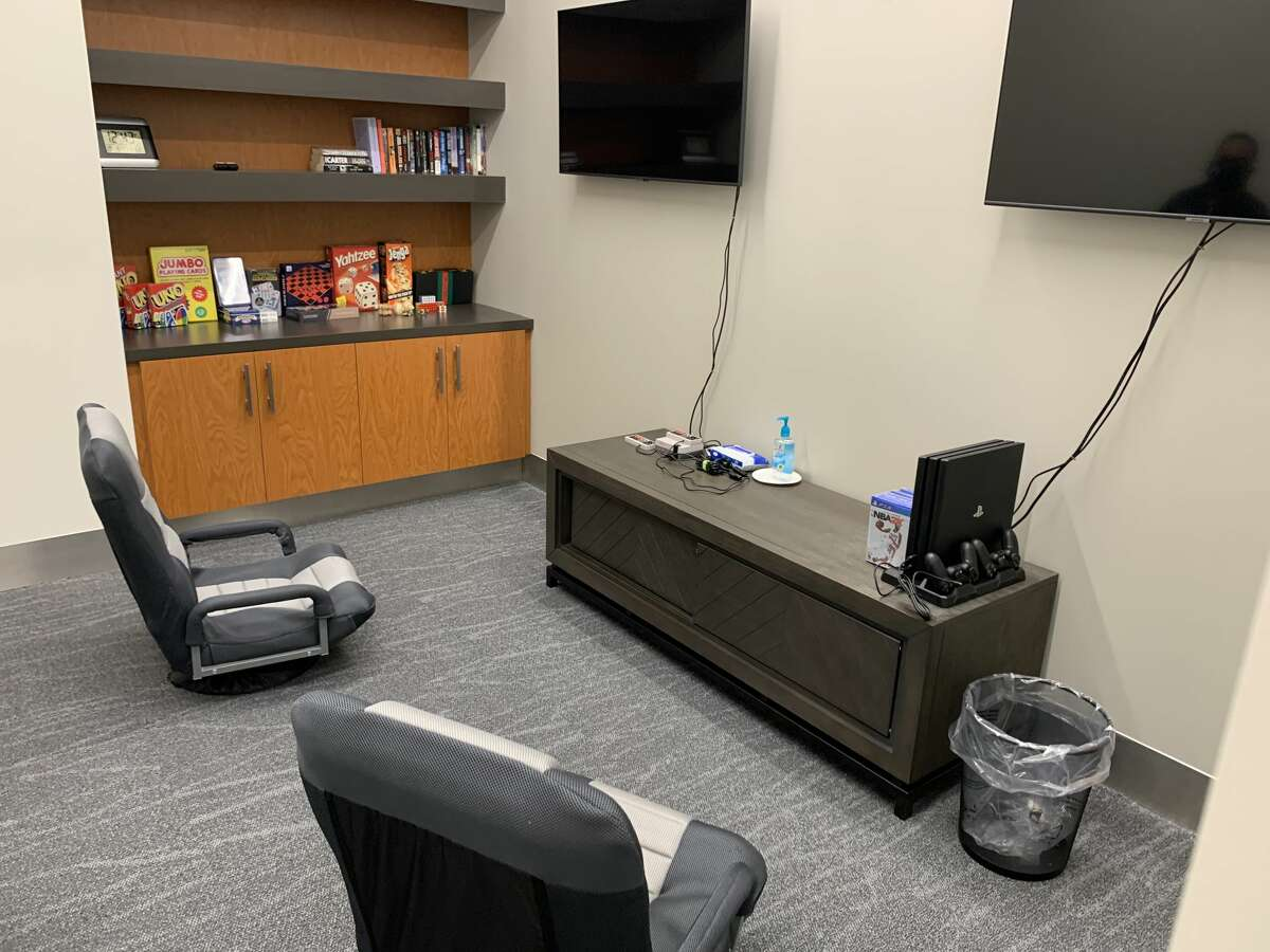 A gaming room features PS4 and retro Nintendo gaming consoles, precisely what young service members need to pass the time before a flight.