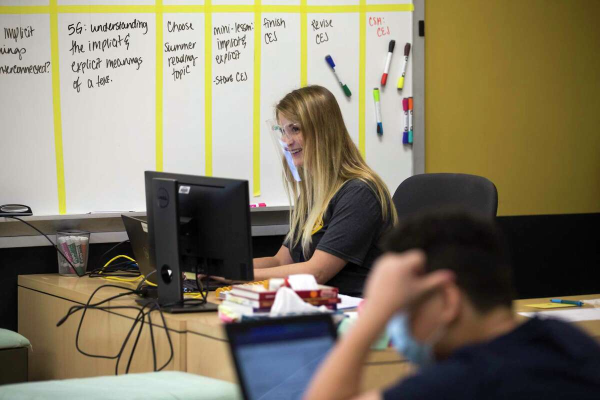 English teacher Mallory Lebel runs her class, in person and virtual, from her computer monitor in the front of the classroom on the first day of in-person classes at Spring Woods High School Tuesday, Sept. 8, 2020 in Houston.