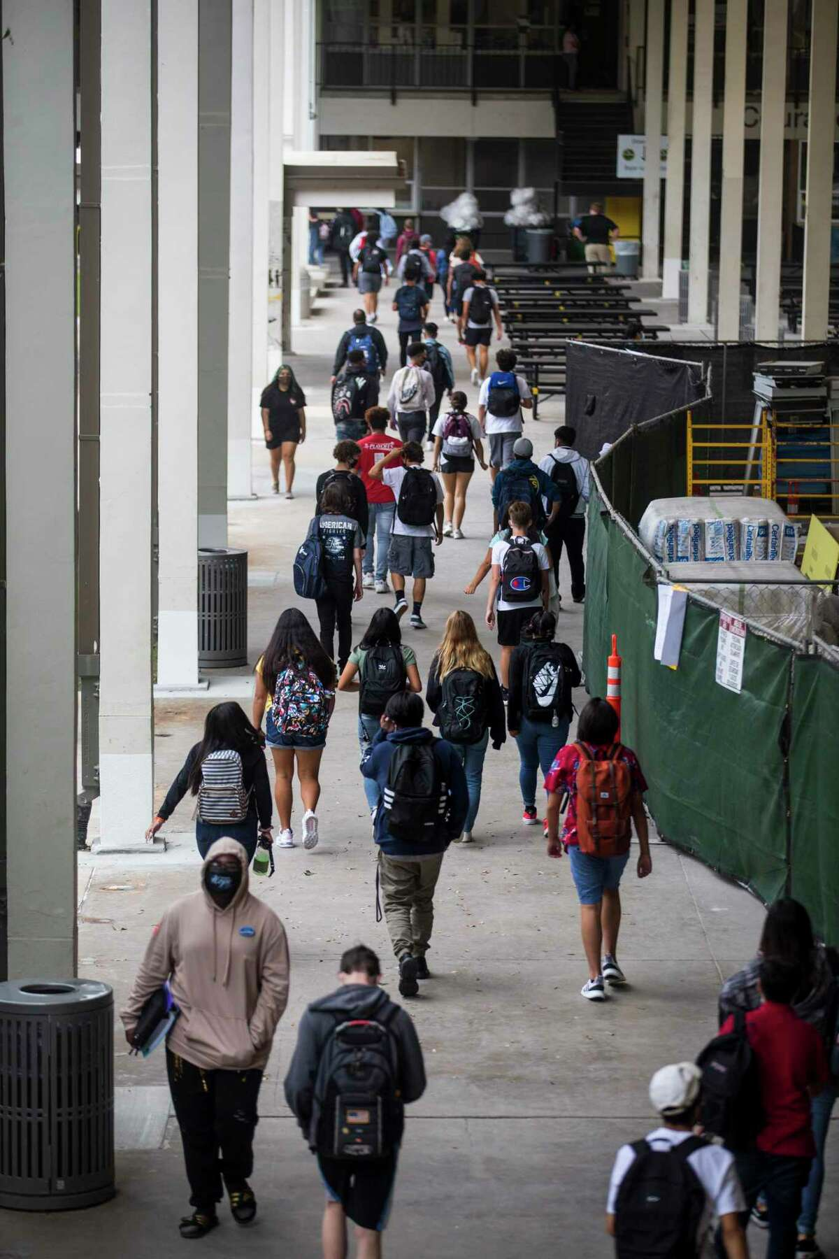 Students pass between classes on the first day of in-person classes at Spring Woods High School Tuesday, Sept. 8, 2020 in Houston.