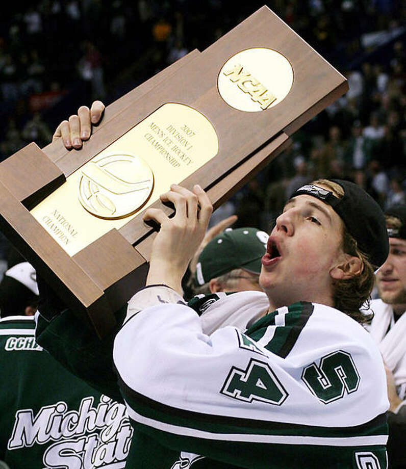 Michigan State Spartans defenseman Mike Ratchuk skates with the 2007 NCAA Frozen Four Championship Trophy at Scotttrade Center in St. Louis after a 3-1 win over Boston College. The NCAA Wednesday announced the 2025 NCAA Frozen Four and a 2024 hockey regional will be played in St. Louis. Photo: UPI File Photo