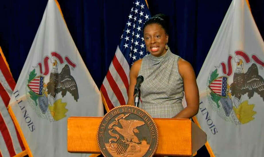 Dr. Ngozi Ezike, director of the Illinois Department of Public Health, gives holiday COVID-19 guidance at a news conference Wednesday in Chicago.