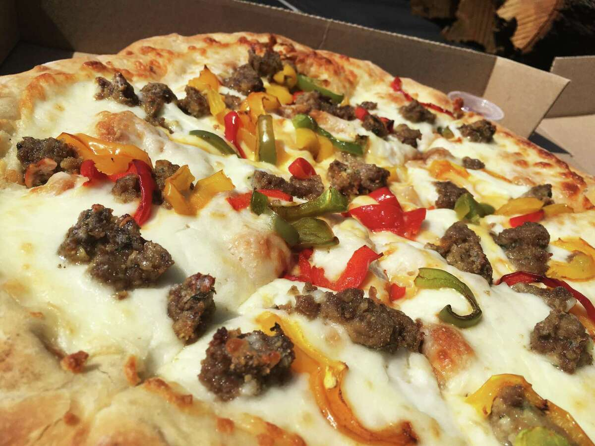 Catalano's Stuffed Pizza ($23 for a 14-inch) with meatballs and bell peppers bridges the gap between a classic hand-tossed style and the deep-dish Chicago style.