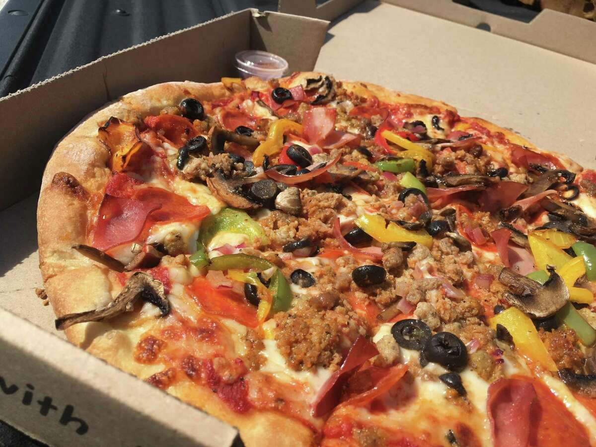 The Catalano's Specialty Pizza at Catalano's Pizzeria in Cibolo comes with a mountain of meats and vegetables.