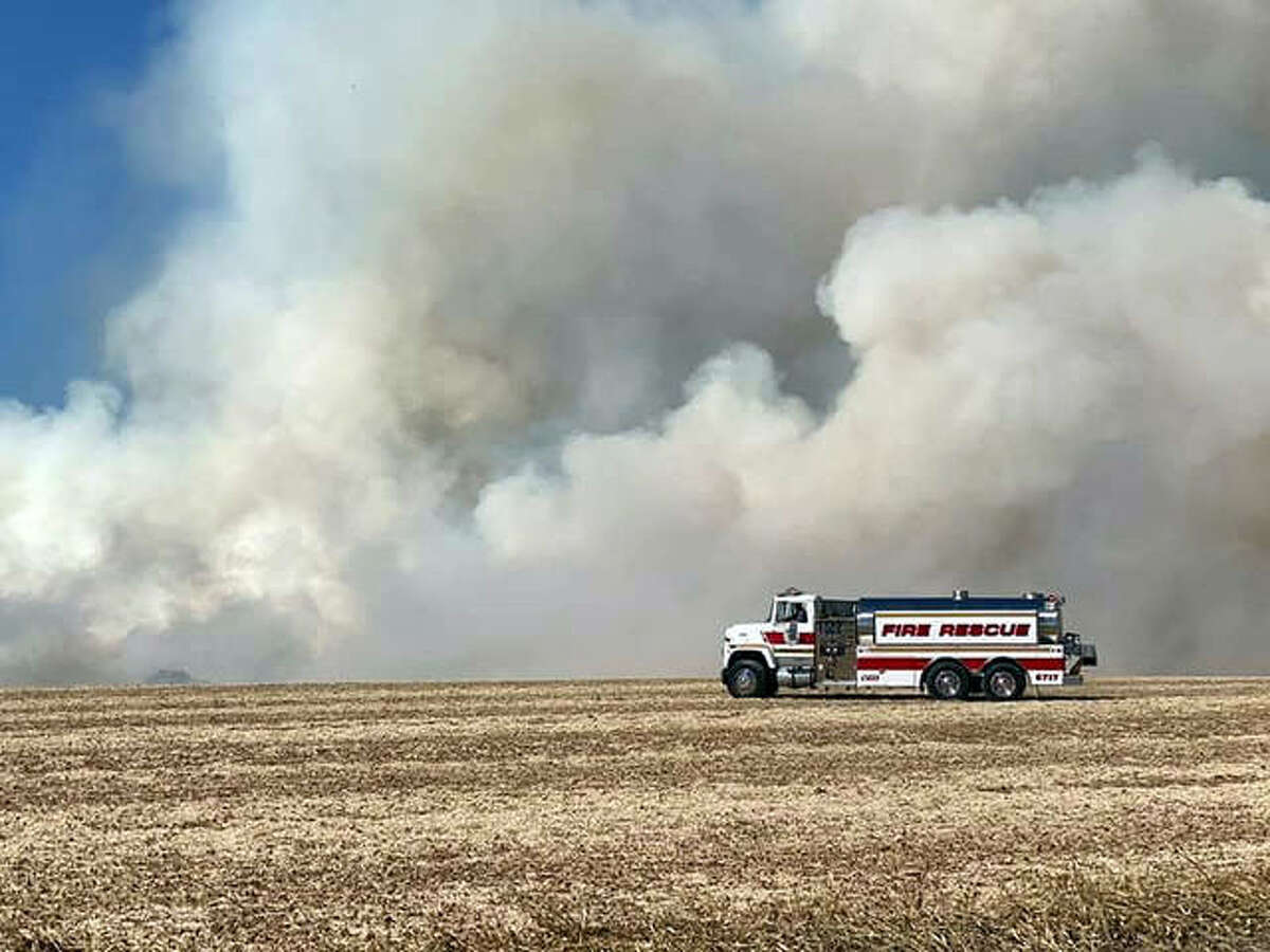 Firefighters battle a field fire near Lebanon Tuesday. Fire crews from Lebanon, Sugar Creek and Mascoutah were on the scene. It was one of multiple field fires that broke out around the Metro East.