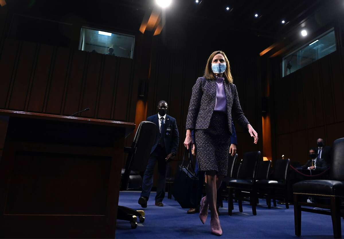 Amy Coney Barrett, President Trump's nominee to the Supreme Court, leaves after testifying during the third day of her confirmation hearings before the Senate Judiciary Committee.