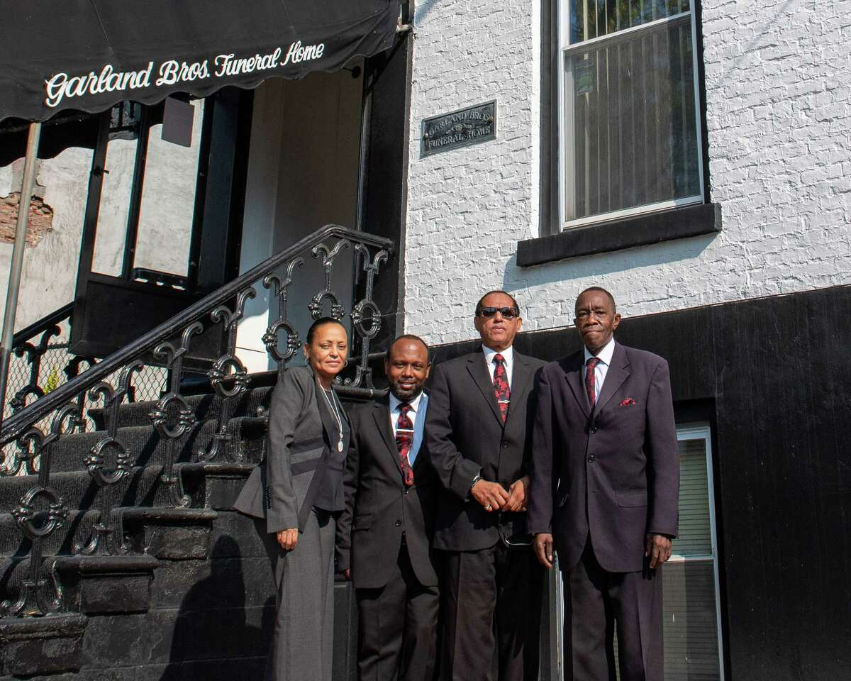 The staff at Garland Brothers Funeral home on Clinton Avenue in Albany, NY, on Saturday, Oct. 10, 2020, prior to the services for Dary Taylor, of Hudson, NY. From left: Philippa Garland-Wilcox, Rahmar Lockridge, Rodney Garland and the Rev. Thomas V. House Jr. (Jim Franco/special to the Times Union.)