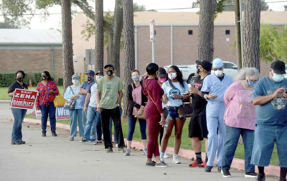 A long line stretched along the drive at Rogers Park, extending onto Gladys Avenue, before polls opened at 8 a.m. for the first day of early voting in Texas. Photo taken Tuesday, October 13, 2020 Kim Brent/The Enterprise Photo: Kim Brent / The Enterprise / BEN