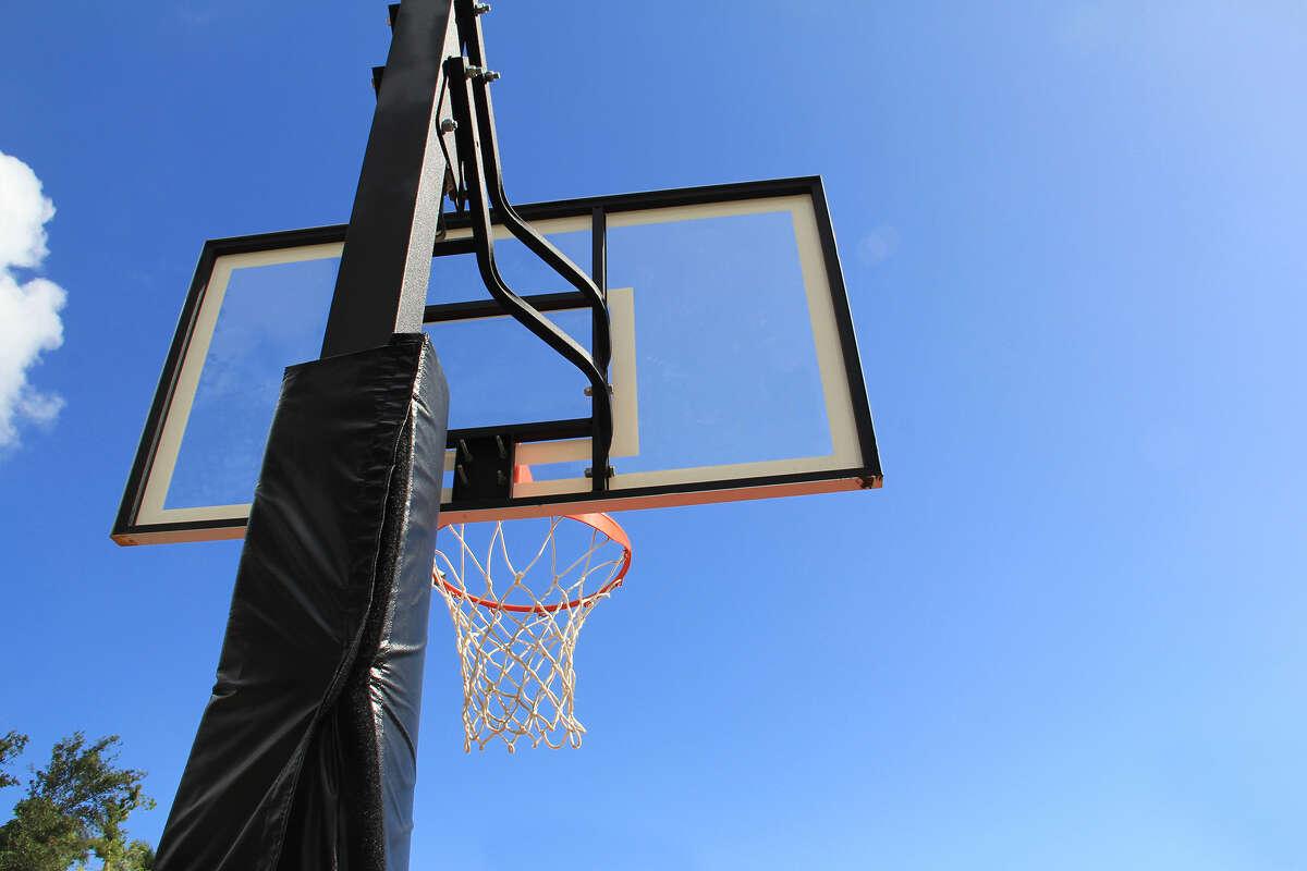 An in-ground basketball hoop.