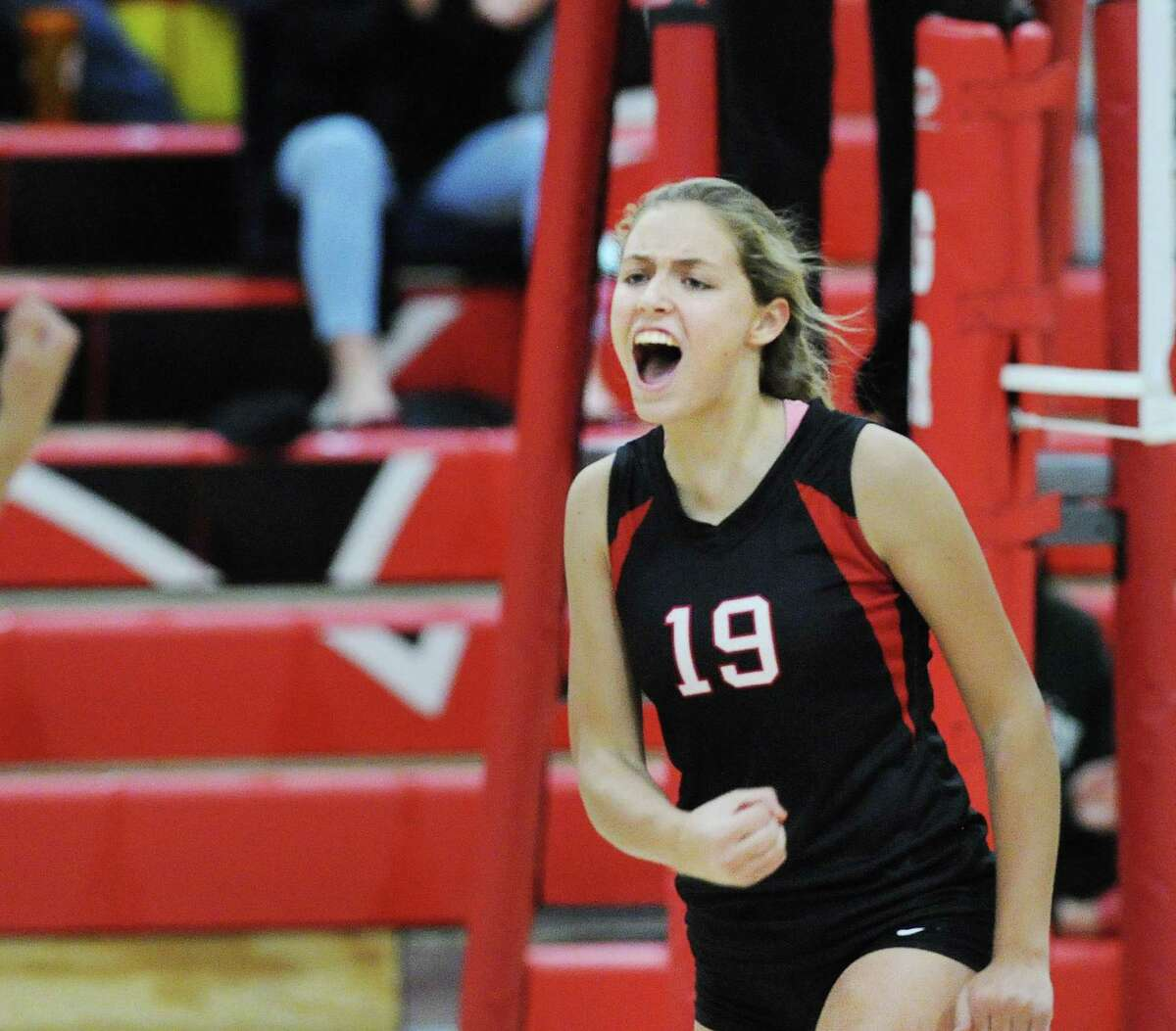 Fairfield Warde's Clare Edminster (#19) reacts after a winning point during the girls high School volleyball match between Greenwich High School and Fairfield Warde High School at Greenwich, Conn., Friday, Oct. 19, 2018.