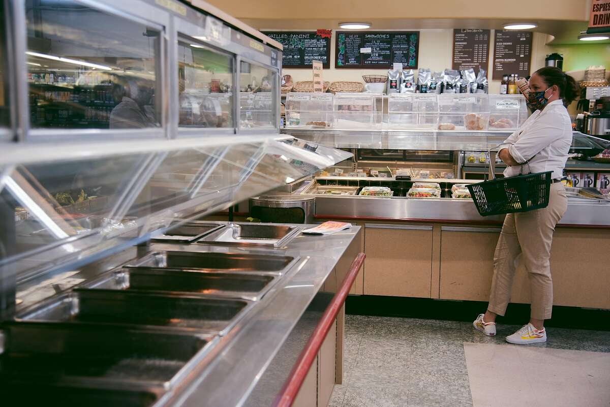 A self-help food counter is now empty at Cal Mart in Calistoga, shut down by coronavirus restrictions. Pending power shut-offs have further reduced demand for perishable food.