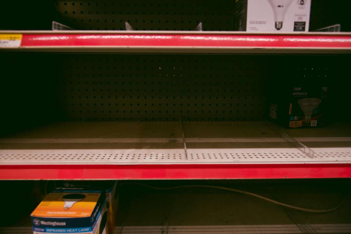 Many shelves are empty at Silverado Ace Hardware in Calistoga as people buy supplies to help get through the shut-offs.
