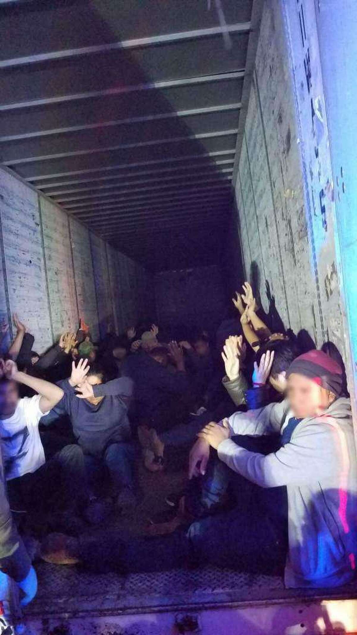 U.S. Border Patrol agents discovered 63 people in the back of a trailer. All were determined to be immigrants who had crossed the border illegally. The truck driver was sentenced to 41 months in prison on Wednesday