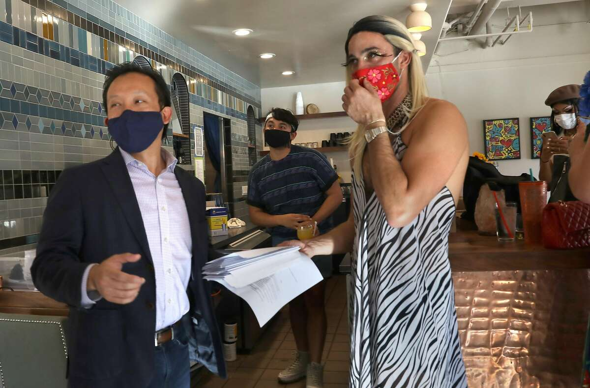 David Chiu with owner Manny Yekutiel at Manny's as they participate in an election event writing letters to swing state voters on Tuesday, Oct. 13, 2020, in San Francisco, Calif.