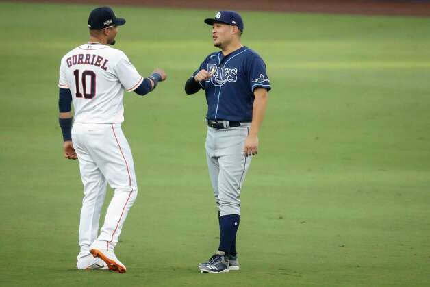 Houston Astros Yuli Gurriel (10) and Tampa Bay Rays Ji-Man Choi talk in the outfield before Game 4 of the American League Championship Series at Petco Park Wednesday, Oct. 14, 2020, in San Diego. Photo: Karen Warren, Staff Photographer / © 2020 Houston Chronicle