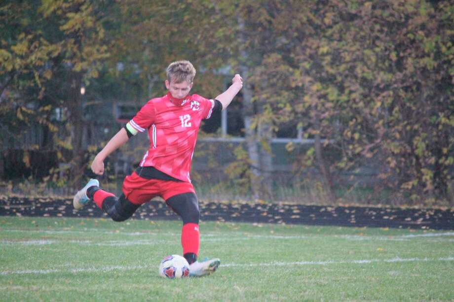 Reed City's Parker Benedict gets ready to kick the ball in Wednesday's match with Hart. (Pioneer photo/John Raffel)