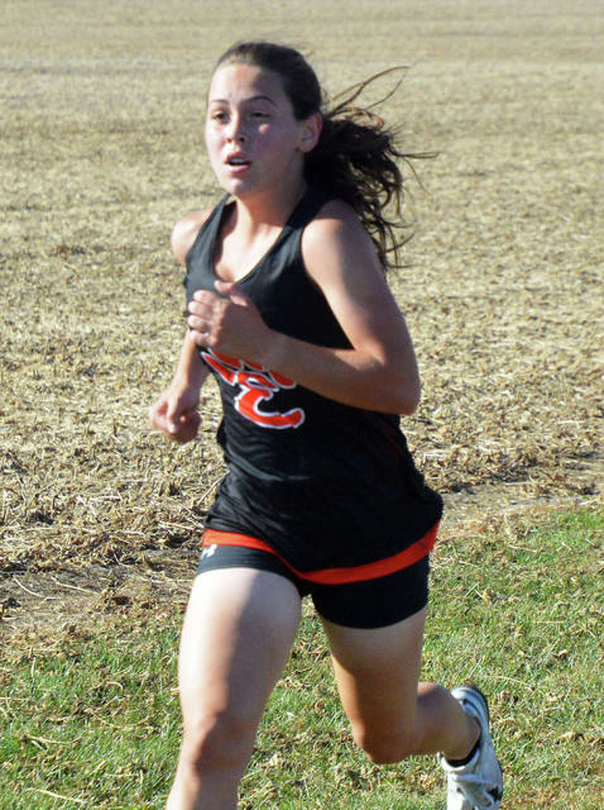 Edwardsville's Olivia Coll is on her way to a first-place finish in the O'Fallon Junior Varsity Championship on Wednesday.