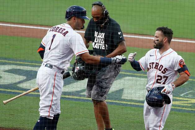 Houston Astros Carlos Correa (1) slaps hands with Jose Altuve as he meet him at the dugout after Altuve hit a solo home run off Tampa Bay Rays starter Tyler Glasnow during the first inning of Game 4 of the American League Championship Series at Petco Park Wednesday, Oct. 14, 2020, in San Diego. Photo: Karen Warren, Staff Photographer / © 2020 Houston Chronicle