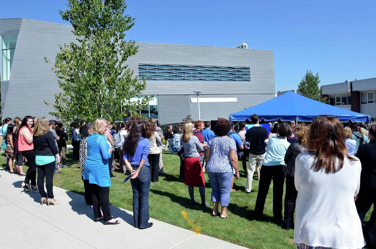(Peter Casolino - New Haven Register) The crowd listens during the speeches on the UNH campus during a ceremony naming the John and Leona Gehring Hall building. The John and Leona Gehring Hall houses the Henry C. Lee Institute of Forensic Science. 09/20/13