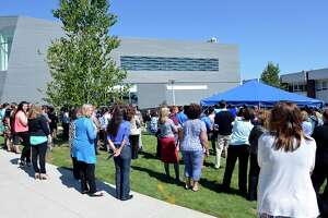 (Peter Casolino — New Haven Register) The crowd listens during the speeches on the UNH campus during a ceremony naming the John and Leona Gehring Hall building. The John and Leona Gehring Hall houses the Henry C. Lee Institute of Forensic Science. 09/20/13